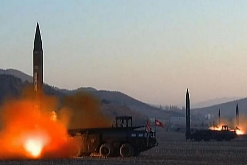 This screen grab taken from North Korean broadcaster KCTV on March 7, 2017 shows ballistic missiles being launced during a military drill from an undisclosed location in North Korea.