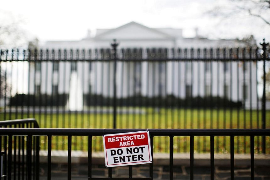 A restricted area sign is seen outside of the White House in Washington.