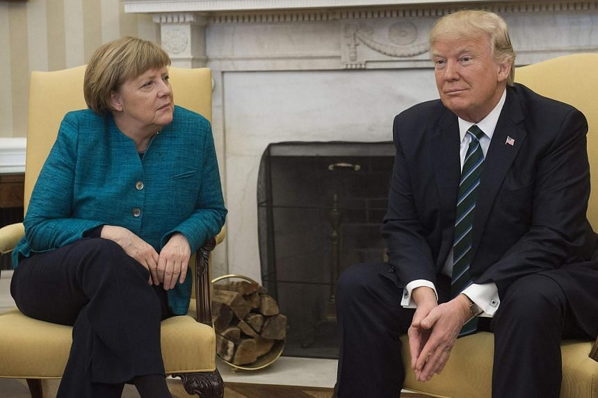 US President Donald Trump and German Chancellor Angela Merkel meet in the Oval Office of the White House in Washington, DC.