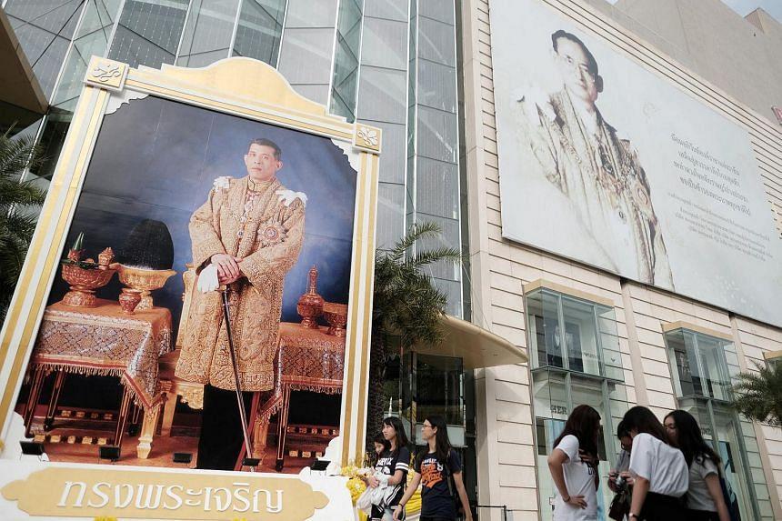 Portraits of Thailand's King Maha Vajiralongkorn (left) and the late King Bhumibol Adulyadej are displayed at a department store in central Bangkok.