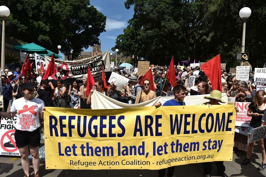 Protesters march on the streets of Sydney's central business district against US President Donald Trump's travel ban policy on Feb 4, 2017.