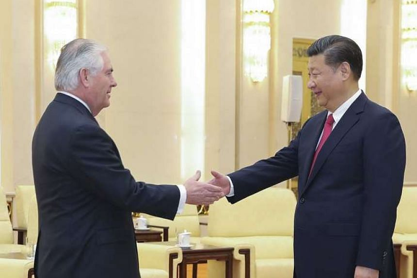 Chinese President Xi Jinping shaking hands with US Secretary of State Rex Tillerson before their meeting at at the Great Hall of the People in Beijing, China, on March 19, 2017.