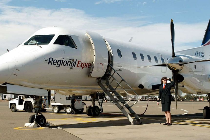 A file photo taken on August 6, 2002, shows Captain Belinda Fleming standing in front of a Regional Express Airlines (REX) plane during the airline's launch at Sydney Airport.