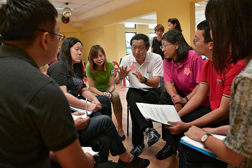 A psychological first aid training session being held for volunteers from Ang Mo Kio GRC on March 12. Psychologists taught them how to stabilise situations after a crisis, approach those affected and identify signs of distress.