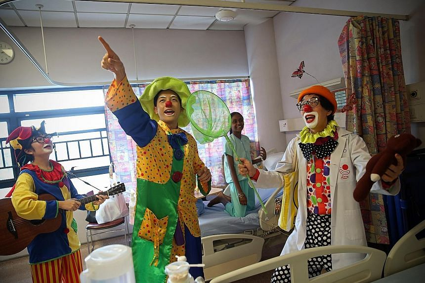 It is International Day of Happiness today and these clowns are wasting no time in bringing cheer to those who need it most. Every last Saturday of the month, the volunteers visit the paediatric wards of KK Women's and Children's Hospital to sculpt b