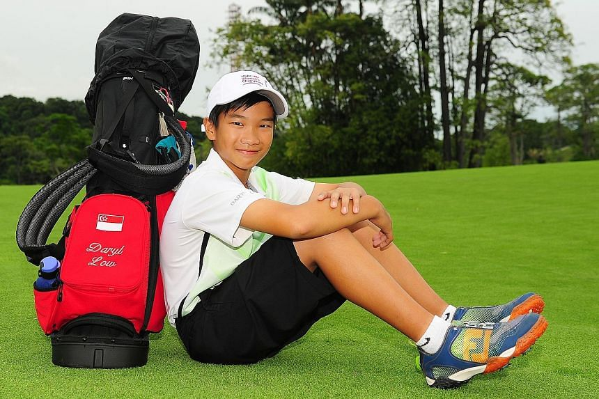 Daryl Low Meng Tiang with his prized golf bag emblazoned with a Singapore flag. The poster in his bedroom reflects his dream to tee off for the nation.