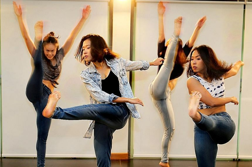 In Future Feed (above, in a rehearsal shot), the choreography of Angela Liong oscillates between gestures of eating and harvesting, and modern dance vocabulary of kicks, spins and dips.