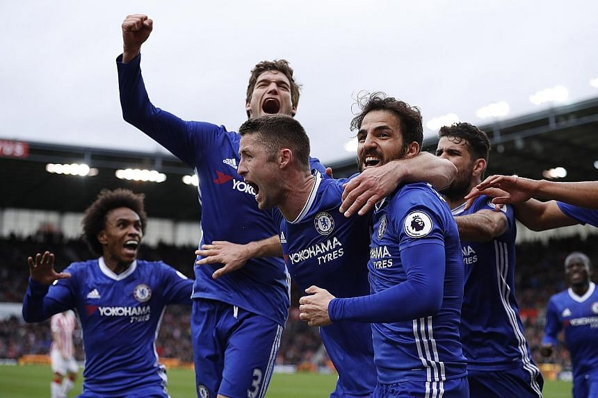 Chelsea players huddling around defender Gary Cahill after his 87th-minute winner as the Blues scraped a 2-1 win over Stoke, despite not being at their best and shorn of their best player in midfielder Eden Hazard. Chelsea next play Crystal Palace at