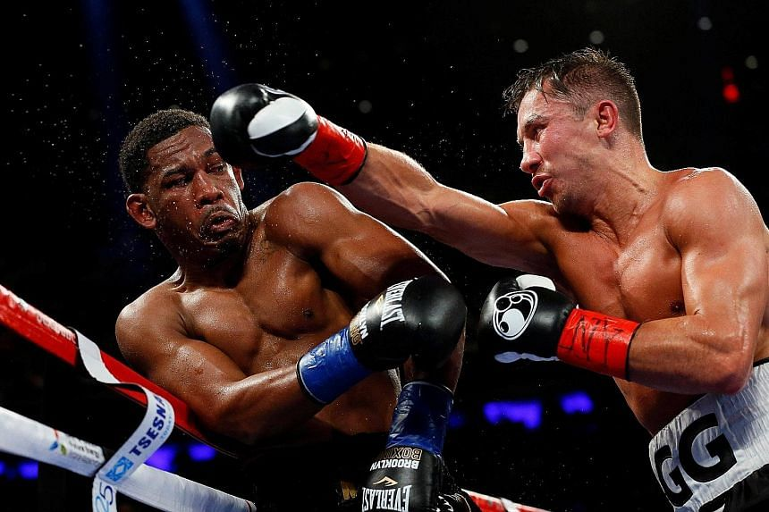 Unbeaten Gennady Golovkin throwing a punch at Daniel Jacobs, as 19,000 fans watched their middleweight world championship fight.