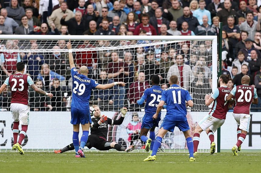 Kasper Schmeichel saving from Andy Carroll as the goalkeeper helped Leicester repel late West Ham attacks for their first away league win in nearly 12 months. It was the Foxes' fourth victory on the trot after the dismissal of Claudio Ranieri.