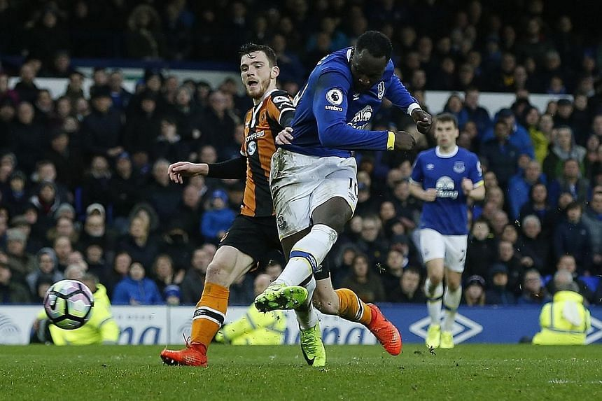 Everton striker Romelu Lukaku slotting home their third goal in the 90th minute. They have a fight on their hands to keep hold of him.