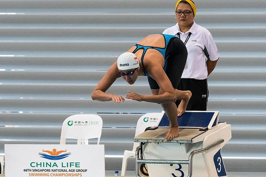 Quah Ting Wen exploding off the blocks on the way to winning the women's 50m freestyle final in a national record of 25.27sec, bettering Amanda Lim's eight-year-old mark.
