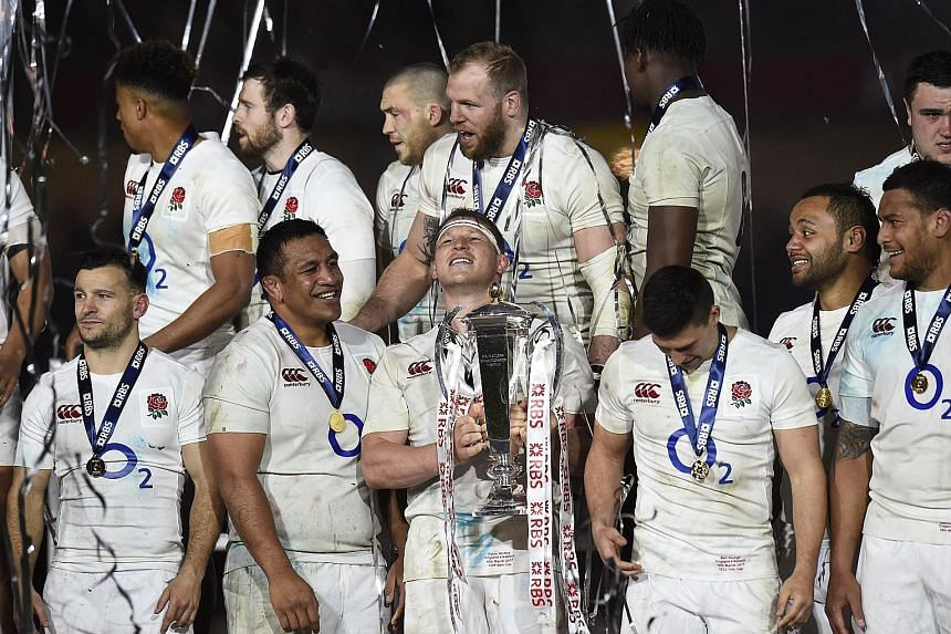 England rugby union hooker and captain Dylan Hartley lifting the Six Nations trophy in Dublin. After losing 9-13 to Ireland, the side remain tied with New Zealand on 18 straight Test wins.