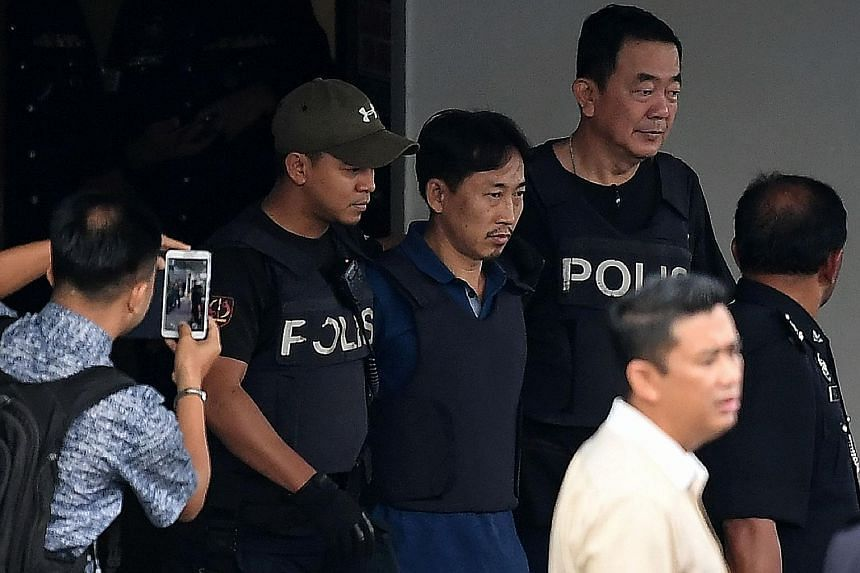 North Korean national Ri Jong Chol being escorted from the Sepang police headquarters in Selangor on March 3. He was deported that day after having been remanded for two weeks in connection with the murder of Mr Kim Jong Nam.