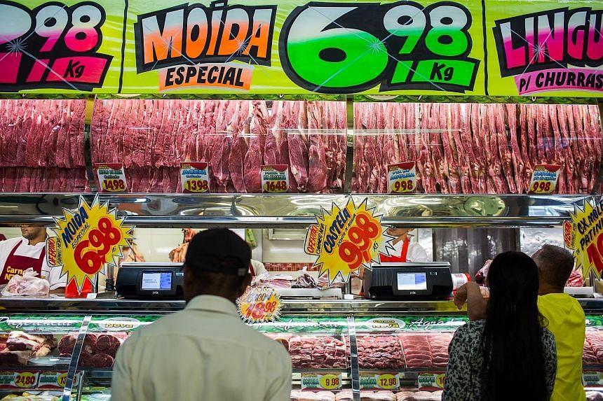 A butchery stall at a market in Sao Paulo. Police say that some of the tainted meat was exported - Brazil is the world's largest beef and chicken exporter.