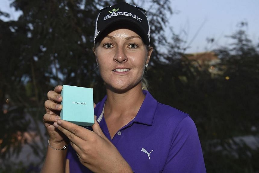 Anna Nordqvist of Sweden holds a Tiffany necklace representing her first win of the 2017 LPGA season after she won the Bank Of Hope Founders Cup at Wildfire Golf Club on March 19, 2017.