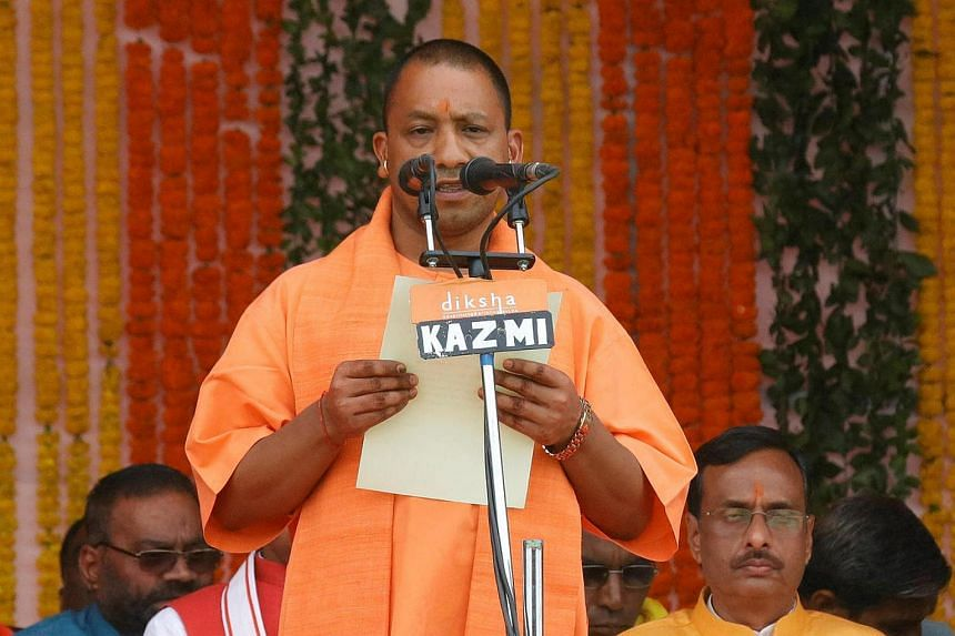 India's ruling BJP leader Yogi Adityanath takes the oath as the new Chief Minister of Uttar Pradesh during a swearing-in ceremony in Lucknow.
