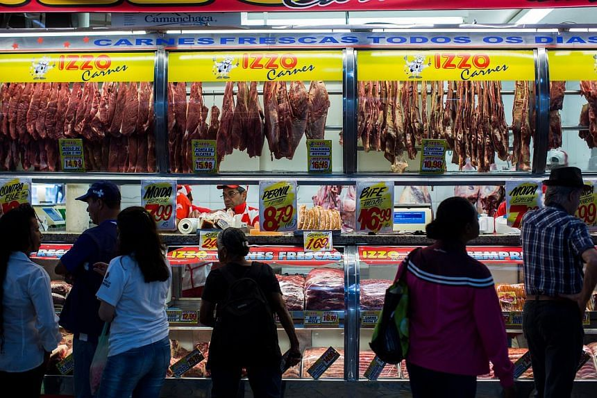 Customers waiting to buy meat from a stall in a market in Sao Paulo, Brazil, on Saturday (March 18).