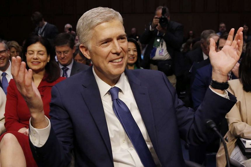 US Supreme Court nominee judge Neil Gorsuch gestures as he arrives for his confirmation hearing in Washington, DC on Monday (March 20).