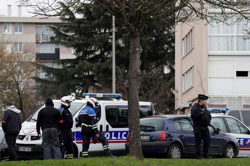 Police officers investigate at the house of the suspect of an attack at Paris' Orly airport,on March 18, 2017.