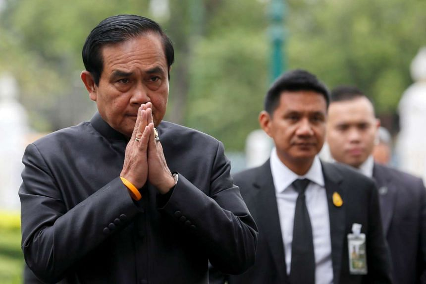 PM Prayut Chan-o-cha gestures in a traditional greeting as his arrives at a weekly cabinet meeting at Bangkok's Government House.