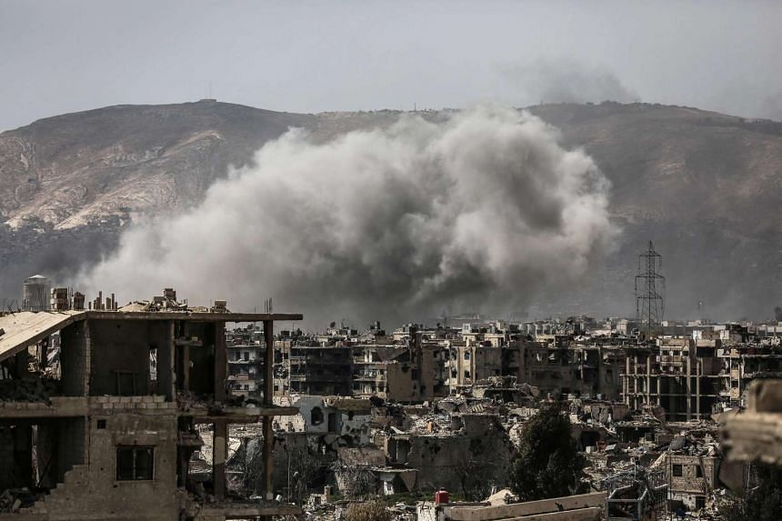 Smoke billows following a reported air strike in the rebel-held outskirts of  Damascus on Sunday (March 19, 2017.