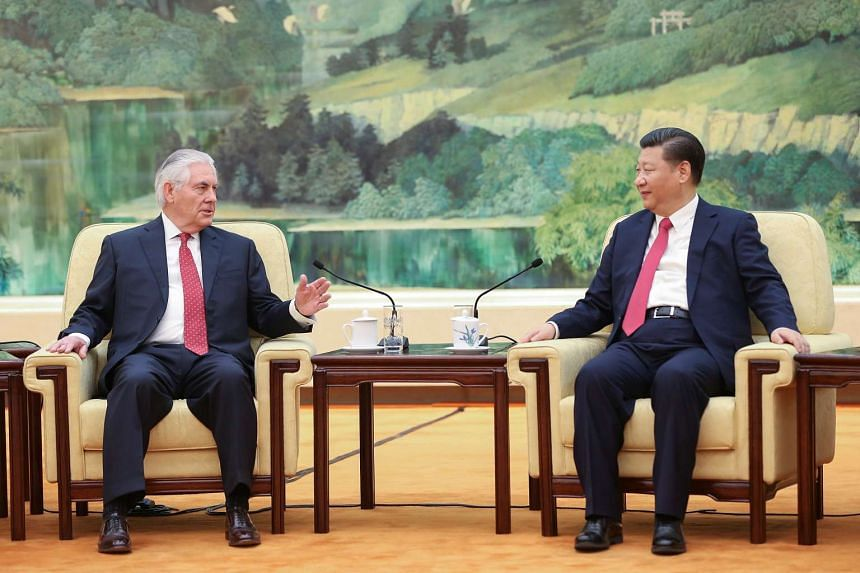 Chinese President Xi Jinping meeting visiting US Secretary of State Rex Tillerson in the Great Hall of the People in Beijing yesterday. China and the US are preparing for the first summit between Mr Xi and US President Donald Trump next month in the