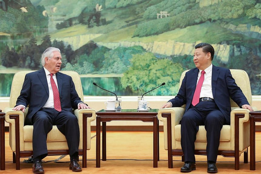 Chinese President Xi Jinping (right) speaking with US Secretary of State Rex Tillerson before their meeting at the Great Hall of the People in Beijing, China, on March 19, 2017 .