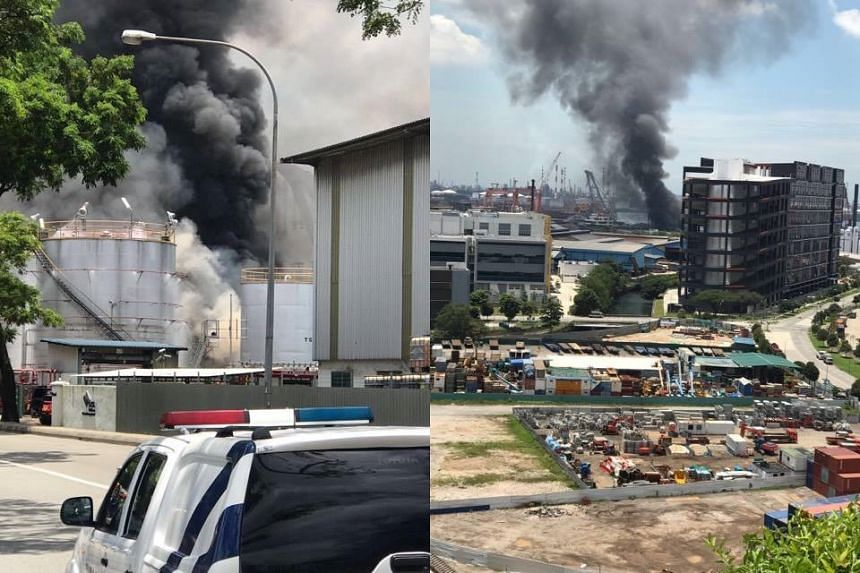 An acrid smell lingered in the air as smoke emitted from one of three tanks inside the building's premises.