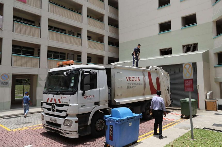 The garbage truck which the man's body fell onto as its unsuspecting crew continued with their daily routine on March 21, 2017, at Tampines Street 42.