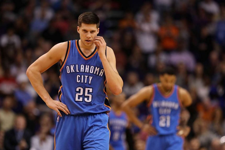 Doug McDermott #25 of the Oklahoma City Thunder reacting as he walks off the court during the second half of the NBA game against the Phoenix Suns.
