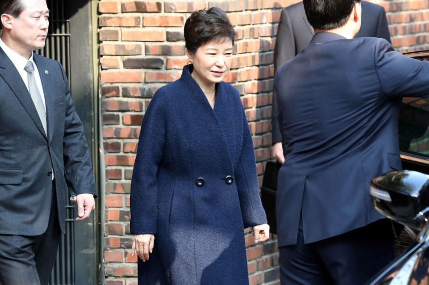 South Korea's ousted leader Park Geun Hye heads to the prosecutors' office to be questioned over a widening corruption scandal in Seoul, South Korea, on March 21, 2017.