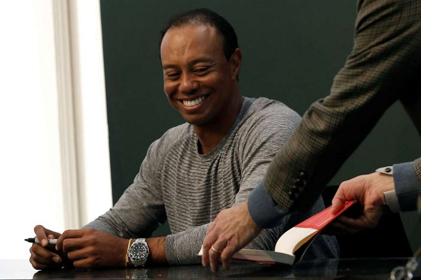 Tiger Woods signing autographs at a Barnes & Noble store in New York on March 20, 2017.