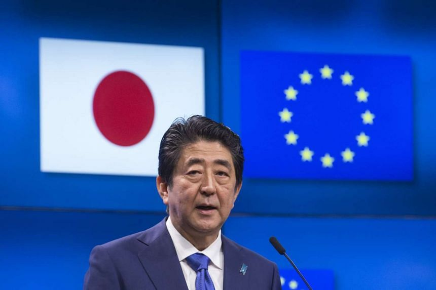 Japanese PM Shinzo Abe speaking at the EU-Japan leaders' meeting in Brussels on March 21, 2017.