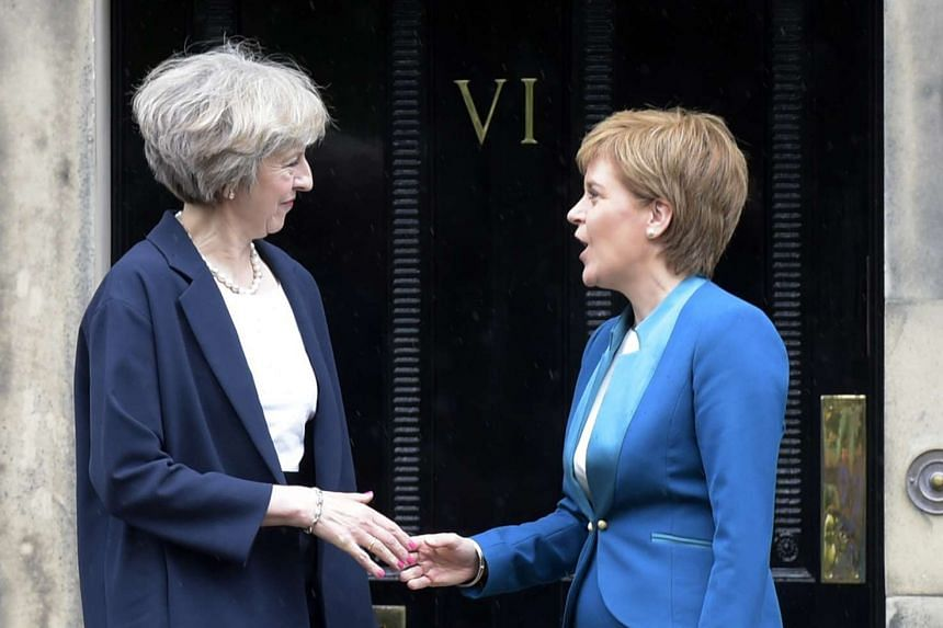 Britain's Prime Minister Theresa May (left) being greeted by Scotland's First Minister Nicola Sturgeon (right) as she arrives for talks at Bute House, in Edinburgh.