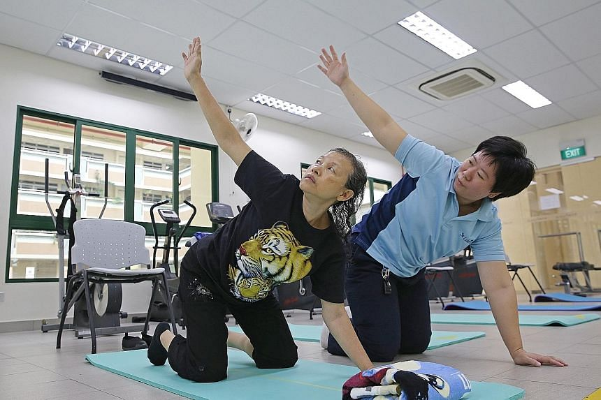 Madam Chan Puay Chin copes with Parkinson's disease with regular sessions under the guidance of therapist Nancy Ho.