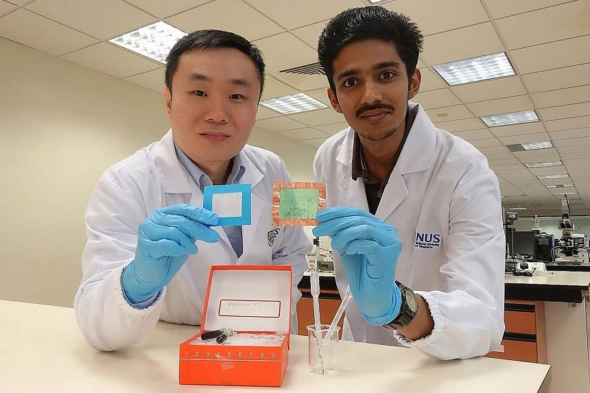 A team from NUS has developed a novel nanofibre solution that can turn a piece of regular mesh (held up by Prof Tan) into an air filter (held up by PhD student Sai Kishore Ravi) which can remove up to 90 per cent of PM2.5 pollutants and achieve 2.5 t