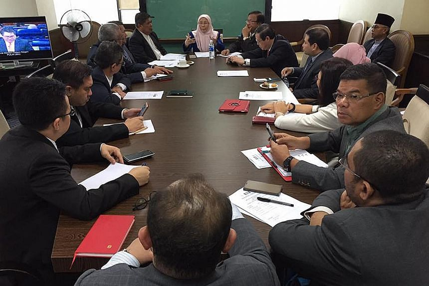 Malaysia's parliamentary opposition leader Wan Azizah Wan Ismail chairing the meeting of Pakatan Harapan's presidential council yesterday. The alliance accepted Dr Mahathir's party into the group to strengthen its chances of winning more seats at the