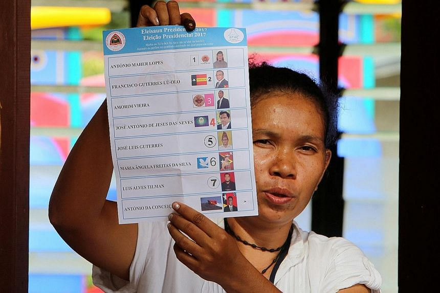 An official with a ballot paper in the capital of Dili, where lines formed as many waited to vote in the fourth presidential election since Timor Leste won its independence from Indonesia in 2002.
