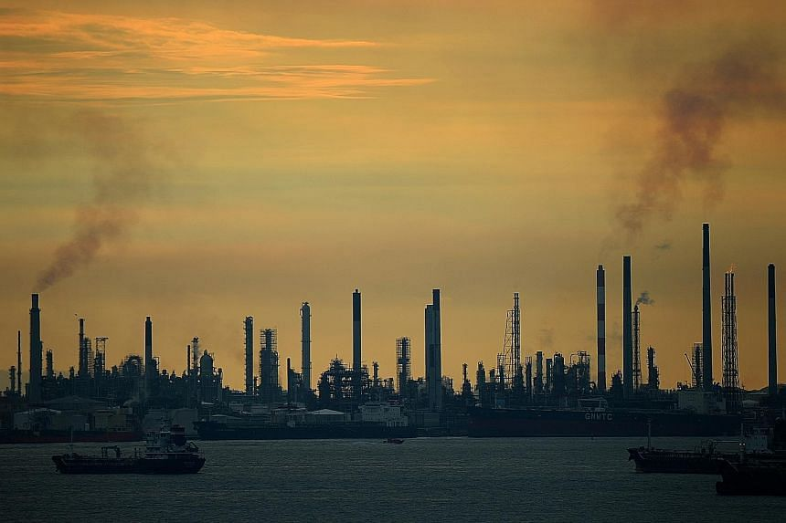 An oil refinery on Pulau Bukom. The added burden from the carbon tax will reduce refineries' competitiveness in the region, said one expert.