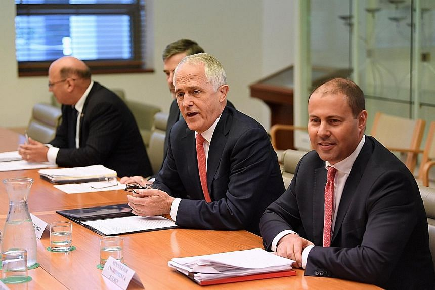 Australian Prime Minister Malcolm Turnbull (centre) attends a meeting at the Parliament House in Canberra, Australia.