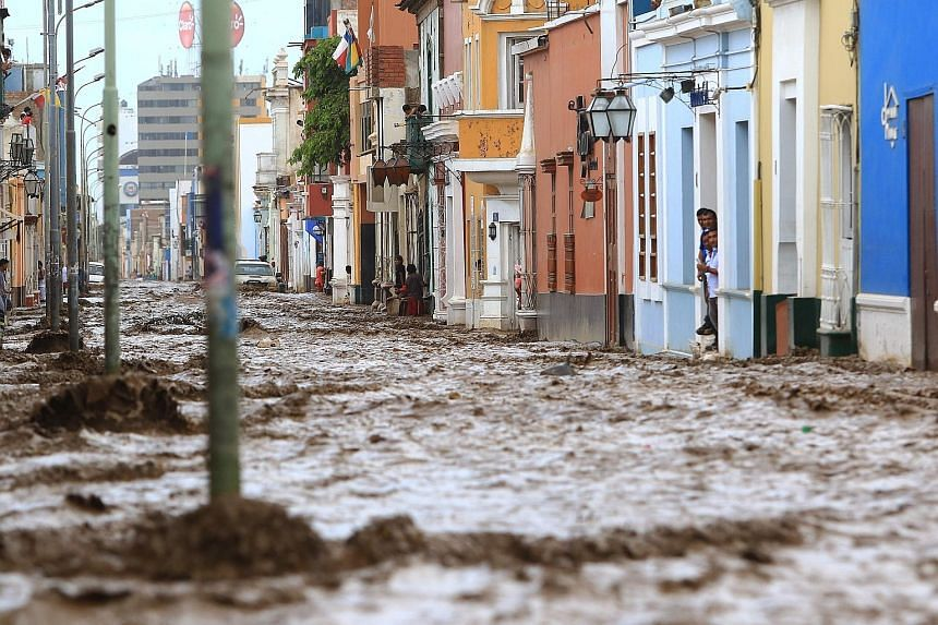The streets of the colourful historic centre of the city of Trujillo, 570km north of Lima, Peru, were transformed into a raging river by a flash flood last Saturday. The El Nino climate phenomenon is causing muddy rivers to overflow along the entire