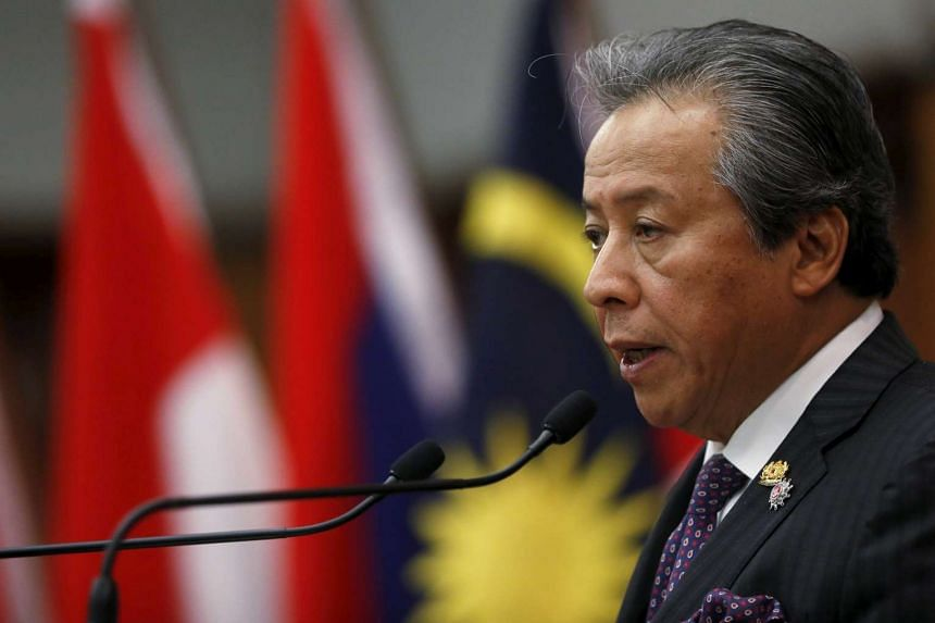 Malaysia's Foreign Minister Anifah Aman speaking to the media after the foreign ministers' meeting at the 26th ASEAN Summit in Kuala Lumpur.