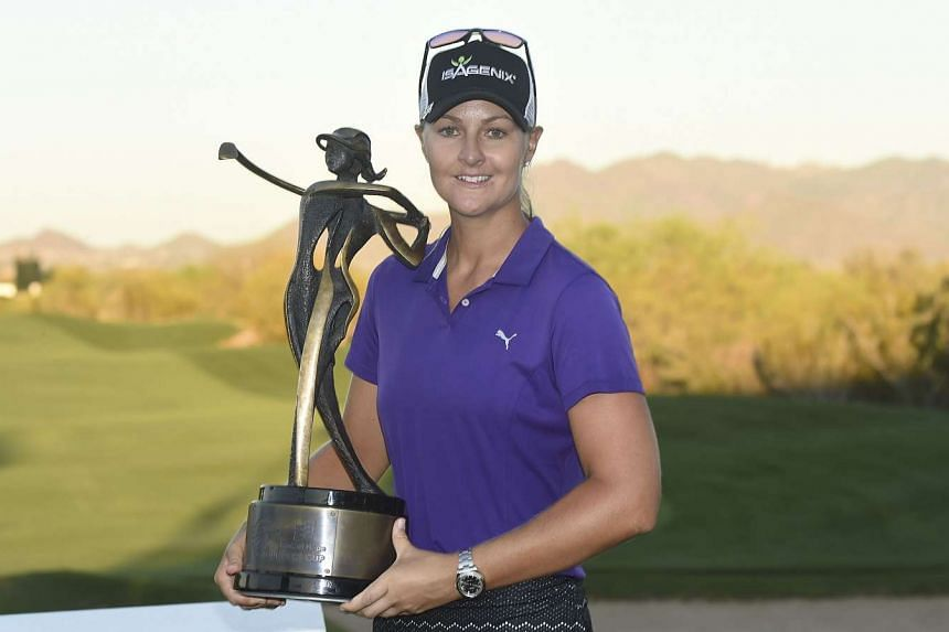 Anna Nordqvist poses with the trophy after winning the Bank Of Hope Founders Cup at Wildfire Golf Club at the JW Marriott Desert Ridge Resort.