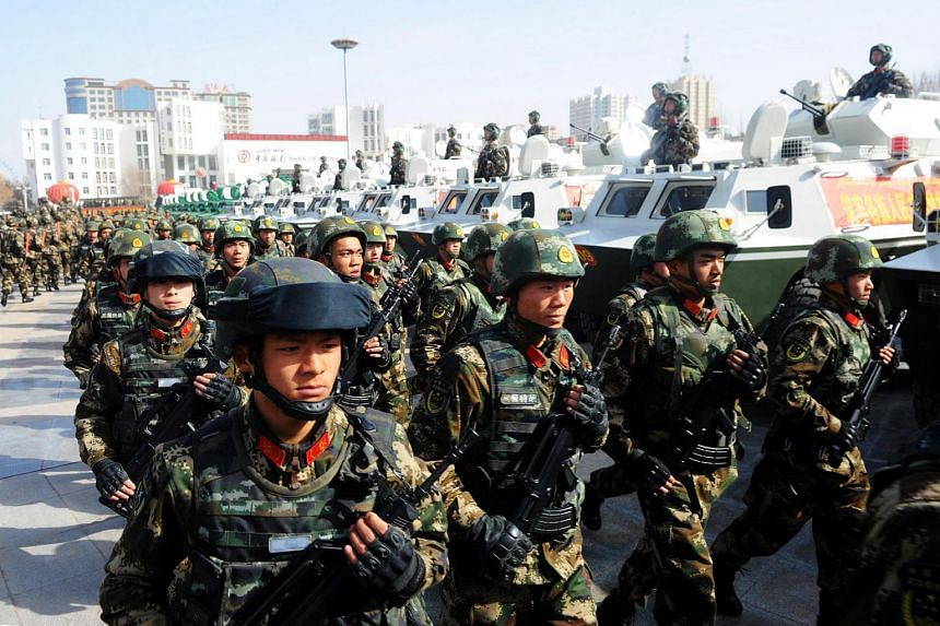 Paramilitary policemen stand in formation as they take part in an anti-terrorism oath-taking rally, in Kashgar, Xinjiang.