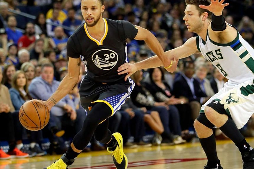 Stephen Curry #30  drives toward the basket in a game on March 18.