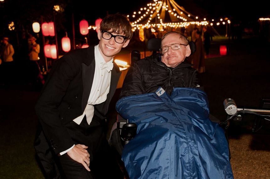 Stephen Hawking (right) with actor Eddie Redmayne who portrayed him in the movie, The Theory Of Everything.