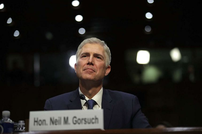 Judge Neil Gorsuch listens during the first day of his Supreme Court confirmation hearing on Monday (March 20).