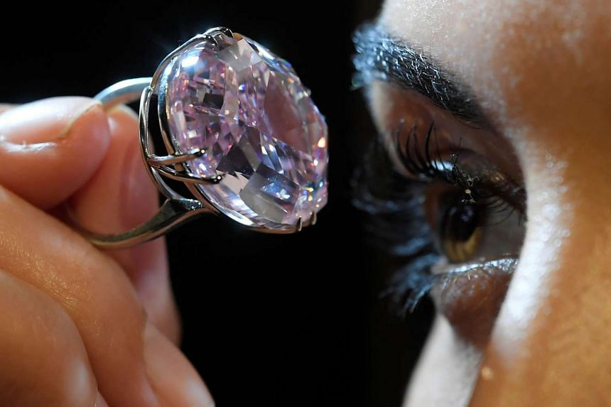 """A model poses with the 59.60-carat """"Pink Star"""" on Monday (March 20)."""