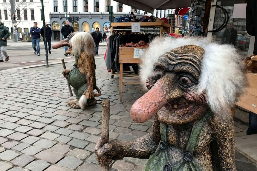 Traditional troll figures are pictured outside a shop in Oslo on March 20.